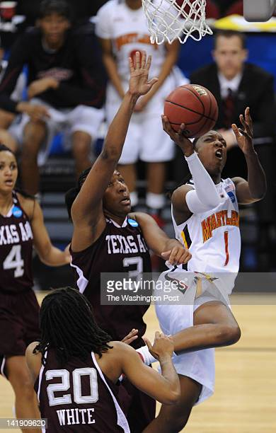 Maryland Terrapins guard Laurin Mincy draws the foul by Texas AampM Aggies center Kelsey Bone and will score the basket during a Regional Semifinal...