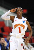 Maryland Terrapins guard Laurin Mincy salutes the crowd after hitting a three point shot against the Texas AampM Aggies during a Regional Semifinal...