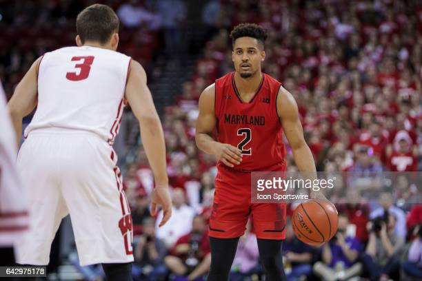 Maryland Terrapins guard Melo Trimble looks to run the offense on Wisconsin Badgers guard Zak Showalter during an college basketball game between the...
