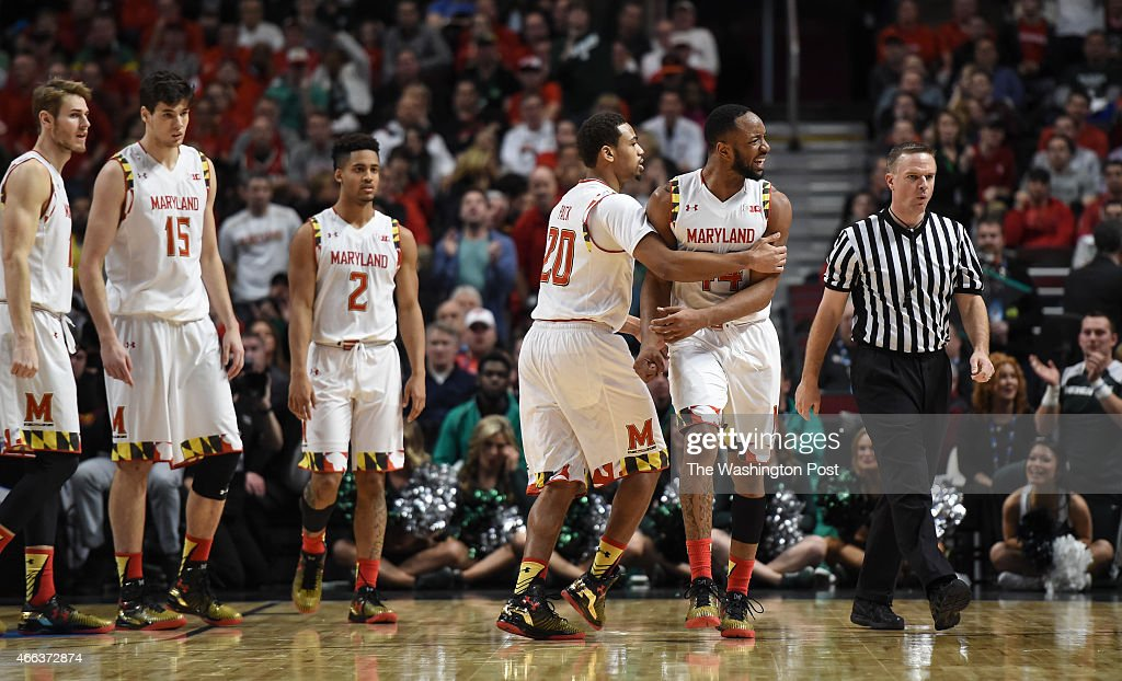 Maryland Terrapins guard Richaud Pack holds back Maryland Terrapins guard/forward Dez Wells as he disagrees with a foul call late in the second half...