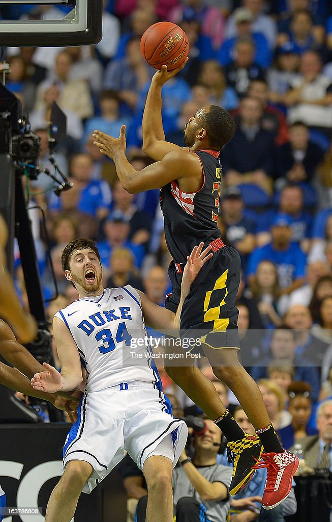 Maryland Terrapins guard/forward Dez Wells (32), right, scores over Duke forward <a gi-track='captionPersonalityLinkClicked' href=/galleries/search?phrase=Ryan+Kelly+-+Jugador+de+baloncesto&family=editorial&specificpeople=15185169 ng-click='$event.stopPropagation()'>Ryan Kelly</a> (34) as the Duke Blue Devils play the Maryland Terrapins in the ACC mens basketball quarterfinal at the Greensboro Coliseum in Greensboro NC, March 15, 2013.