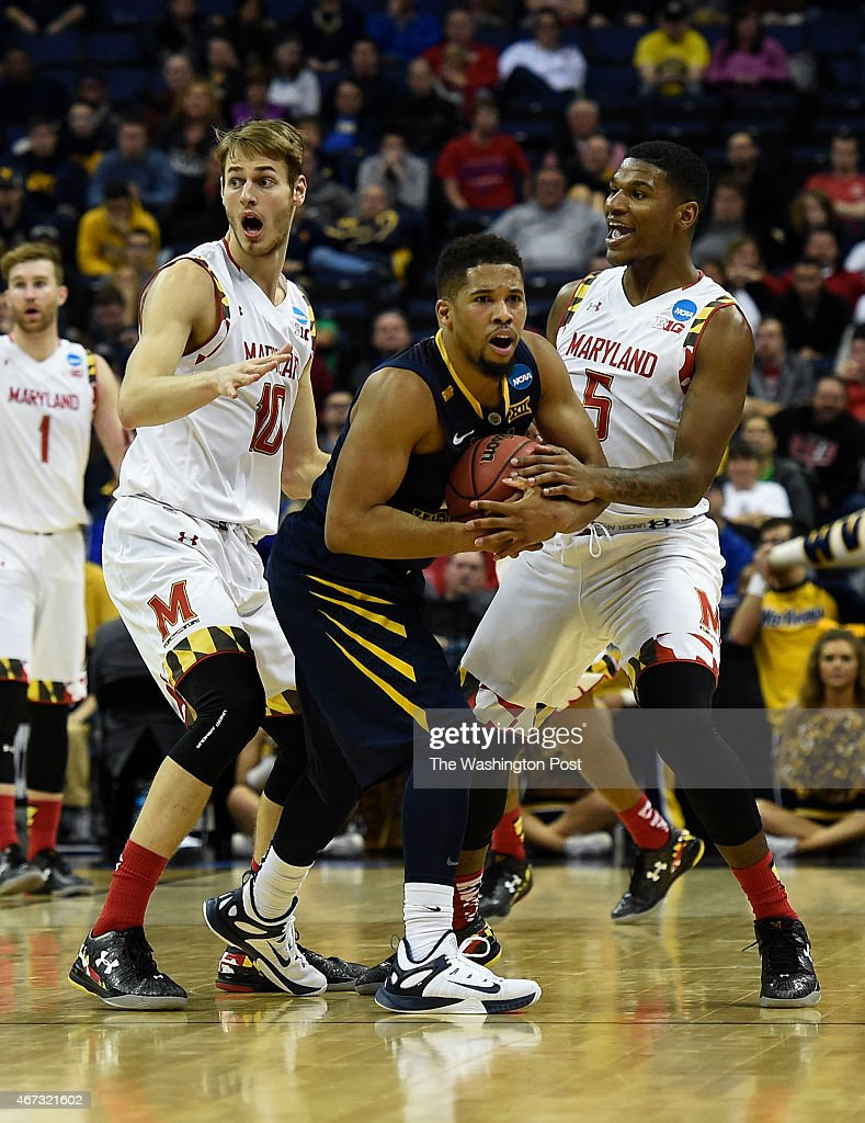 Maryland Terrapins guard/forward <a gi-track='captionPersonalityLinkClicked' href=/galleries/search?phrase=Jake+Layman&family=editorial&specificpeople=9973489 ng-click='$event.stopPropagation()'>Jake Layman</a> (10), left. and Maryland Terrapins guard Dion Wiley (5) react after one of them was called for fouling West Virginia Mountaineers guard Gary Browne (14) late during the second half of the game between the Maryland Terrapins and the West Virginia Mountaineers the NCAA Tournament Midwest Region at Nationwide Arena in Columbus, Ohio, on Sunday, March 22, 2014. The West Virginia Mountaineers defeated the Maryland Terrapins 69-59.