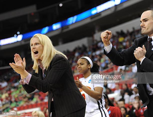 Maryland Terrapins head coach Brenda Frese left cheers after a Terrapin steal during a Regional Semifinal game of the Women's NCAA basketball...