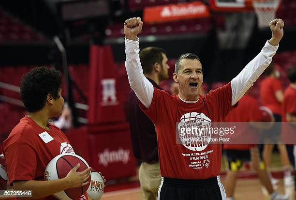 Maryland Terrapins head coach Mark Turgeon cheers for one of the participants during the Terrapins first Special Olympic basketball clinic held after...