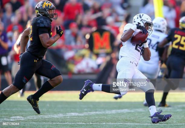 Maryland Terrapins linebacker Isaiah Davis chases after Northwestern Wildcats running back Jeremy Larkin during a college football game between the...