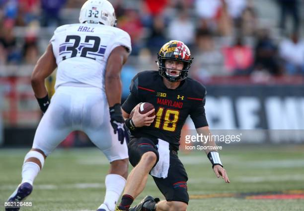 Maryland Terrapins quarterback Max Bortenschlager slides down as Northwestern Wildcats linebacker Nate Hall closes in during a college football game...