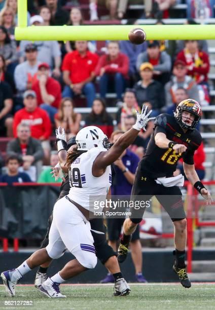 Maryland Terrapins quarterback Max Bortenschlager throws high over Northwestern Wildcats defensive lineman Jordan Thompson during a college football...