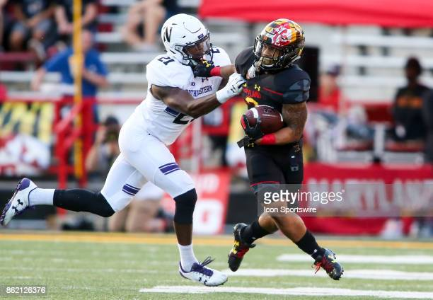 Maryland Terrapins running back Lorenzo Harrison III fends off Northwestern Wildcats safety Kyle Queiro during a college football game between the...