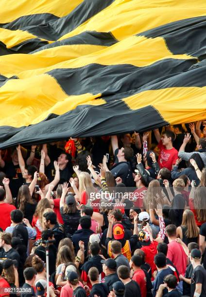 Maryland Terrapins students unfurl a huge state flag during a college football game between the Maryland Terrapins and the Northwestern Wildcats on...