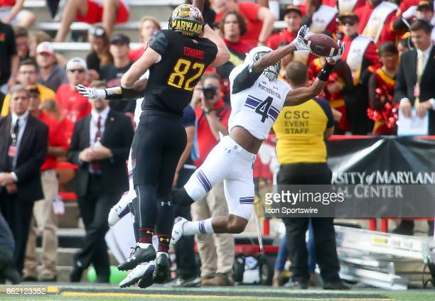 Maryland Terrapins tight end Avery Edwards watches as Northwestern Wildcats defensive back JR Pace intercepts during a college football game between...