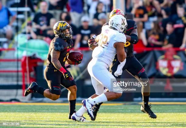 Maryland Terrapins tight end Derrick Hayward blocks Northwestern Wildcats linebacker Nate Hall to allow running back Lorenzo Harrison III to run...