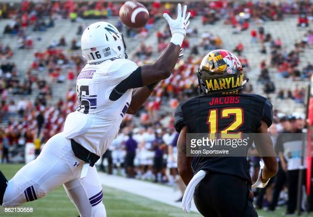 Maryland Terrapins wide receiver Taivon Jacobs watches an attempted catch by Northwestern Wildcats safety Godwin Igwebuike during a college football...