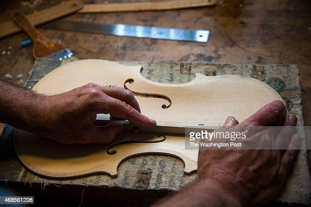 Maryland violin maker Robert McCluskie works on his 401st instrument a viola in his home workshop March 2015 in Potomac MD