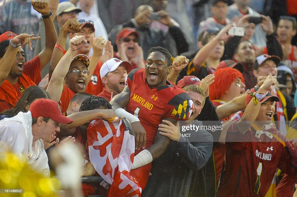 Maryland wide receiver Stefon Diggs celebrates a stunning 37-0 shutout of West Virginia with fellow students following their game at M&T Bank Stadium in Baltimore, Maryland, Saturday, September 21, 2013.