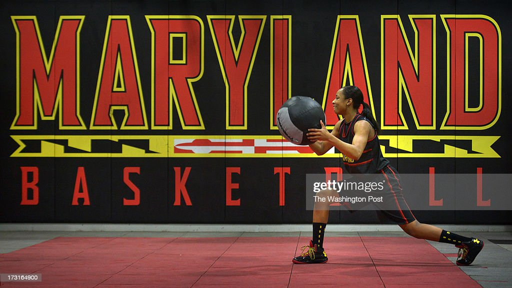 Maryland women's basketball player Brene Moseley handles a medicine ball as she works to rehabilitate her repaired ACL on July, 03, 2013 in College Park, MD.