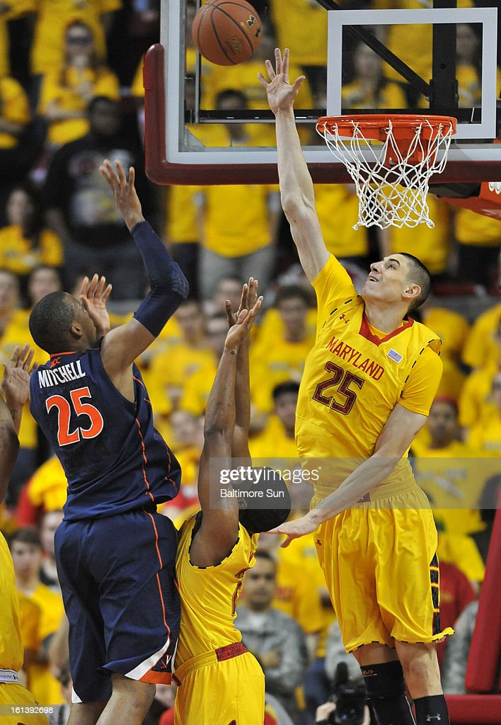 Maryland's Alex Len, right, blocks the shot of Virginia's Akil Mitchell during a men's college basketball game in College Park, Maryland, Sunday, February 10, 2013. Virginia won, 80-69.