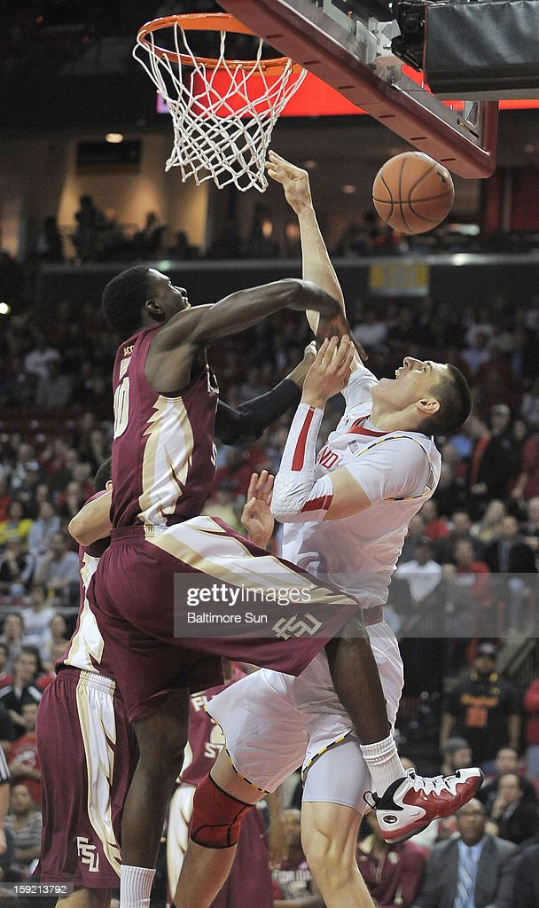 Maryland's Alex Len, right, is fouled on a shot attempt in the first half by Florida State's Okaro White at Comcast Center at College Park, Maryland, on Wednesday, January 9, 2012.