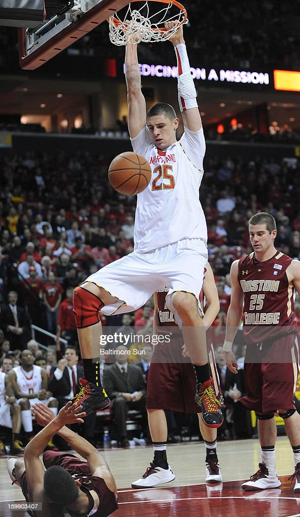 Maryland's Alex Len slams home two and lands on Boston College's Lonnie Jackson at Comcast Center in College Park, Maryland, on Tuesday, January 22, 2013. Maryland won, 64-59.