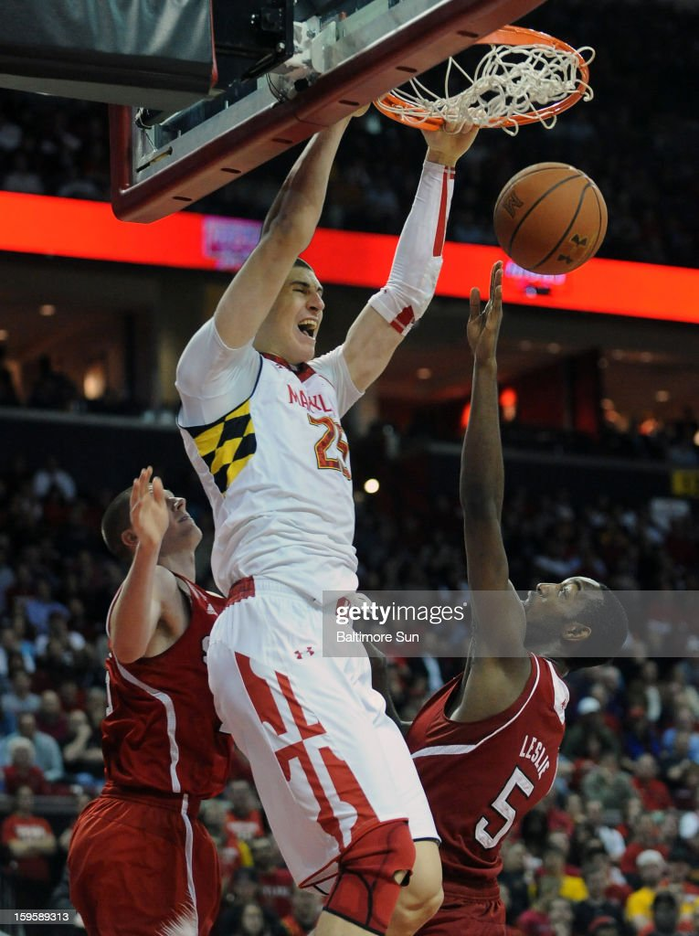 Maryland's Alex Len slams home two over North Carolina State's C.J. Leslie (5) late in the second half at the Comcast Center on Wednesday, January 16, 2013, in College Park, Maryland. The host Terrapins won, 51-50.