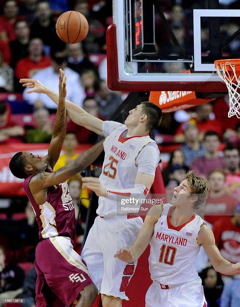 Maryland's Alex Len (25) successfully blocks a first-half shot by Florida State's Aaron Thomas, left, as Maryland's Alex Len (10) monitors at Comcast Center at College Park, Maryland, on Wednesday, January 9, 2012.