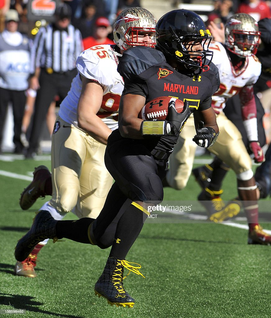 Maryland's Brandon Ross runs for 11 yards and a first down against Florida State in the 1st quarter at Byrd Stadium in College Park, Maryland, on Saturday, November 17, 2012. The Florida State Seminoles defeated the Maryland Terrapins, 41-14.