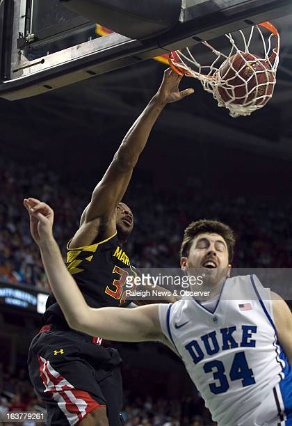 Maryland's Dez Wells dunks on Duke's Ryan Kelly during the first half of an ACC Tournament quarterfinal game at the Greensboro Coliseum in Greensboro...
