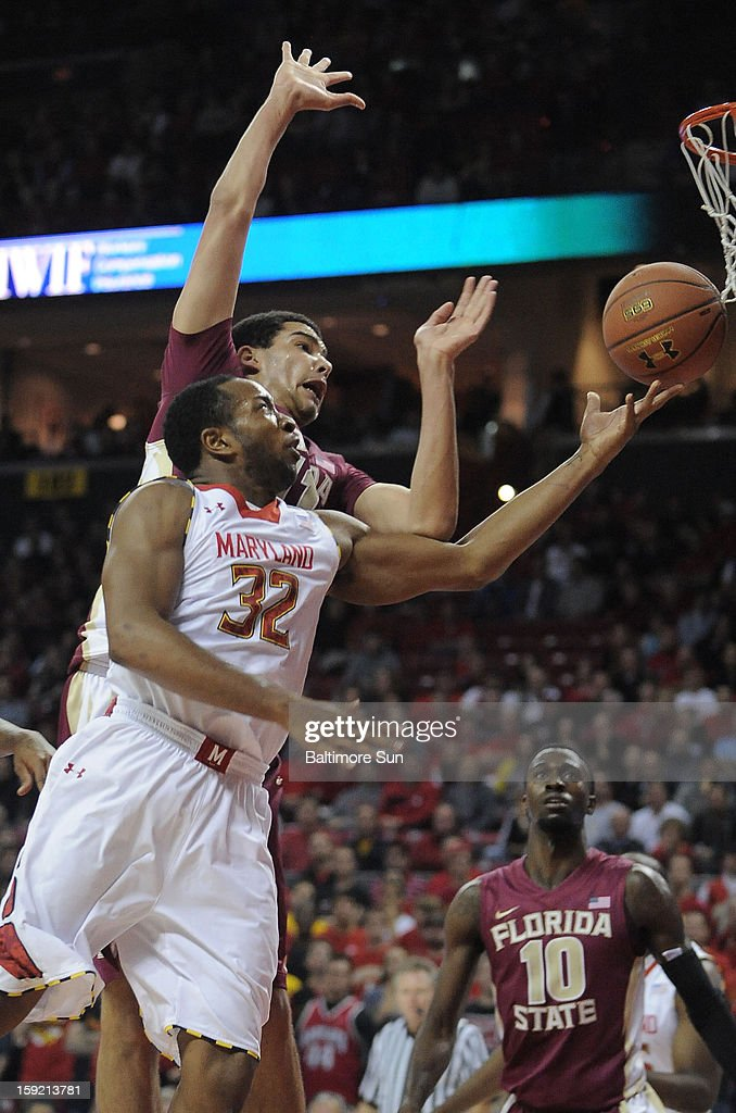 Maryland's Dez Wells (32) lays in two past the defense of Florida State's Kiel Turpin during first-half action at Comcast Center at College Park, Maryland, on Wednesday, January 9, 2012.