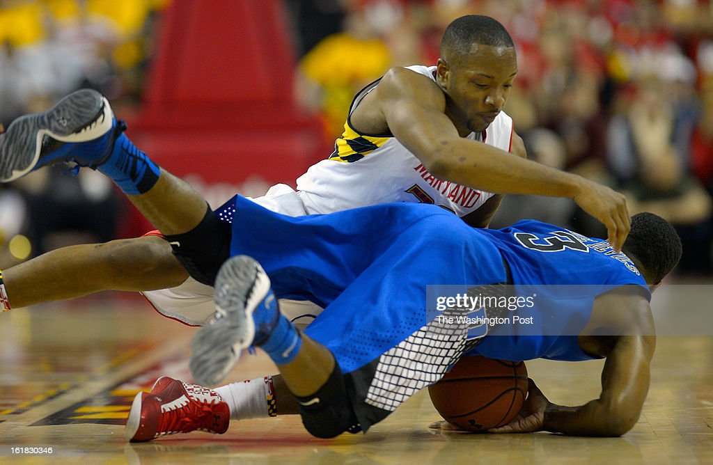 Maryland's Dez Wells (32), left, fouls Duke guard Tyler Thornton (3) after Thornton steals the ball from him during the University of Maryland defeat of Duke 83 - 81in NCAA mens basketball at the Comcast Center in College Park MD, February 16, 2012 .