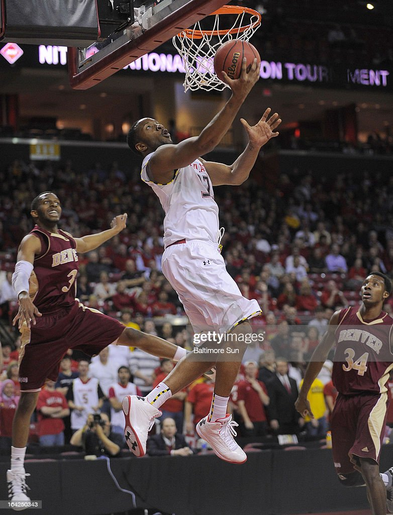 Maryland's Dez Wells puts in two points against Denver in the first half of the NIT basketball tournament at the Comcast Center in College Park, Maryland. Maryland won, 62-52.