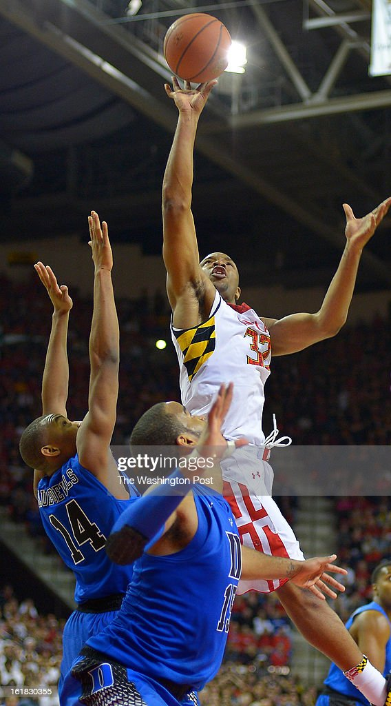 Maryland's Dez Wells (32), right, score over Duke guard Rasheed Sulaimon (14), left, andDuke forward Josh Hairston (15), center, as the University of Maryland defeats Duke 83 - 81in NCAA mens basketball at the Comcast Center in College Park MD, February 16, 2012 .