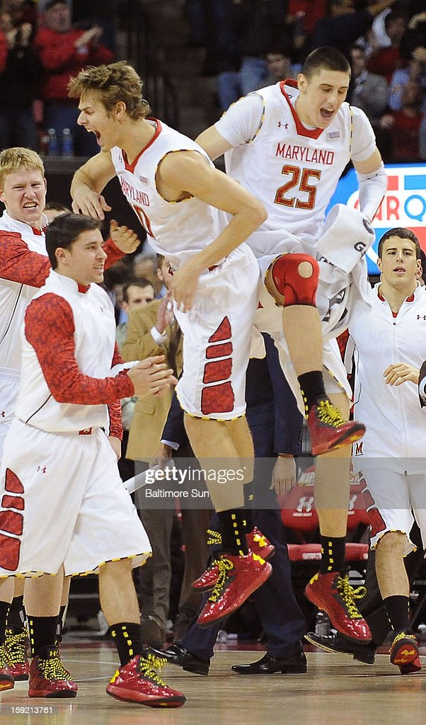 Maryland's Jake Layman and Alex Len (25) celebrate a 3-point shot hit by Maryland in the first half against Florida State at Comcast Center at College Park, Maryland, on Wednesday, January 9, 2012.