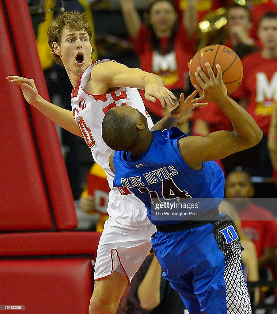 Maryland's Jake Layman (10) , left, fouls Duke guard Rasheed Sulaimon (14) in the 2nd half as the University of Maryland defeats Duke 83 - 81in NCAA mens basketball at the Comcast Center in College Park MD, February 16, 2012 .