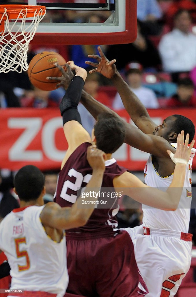 Maryland's James Padgett, right, is able to block a first-half shot attempt by Lafayette's Alan Flannigan (22) at the Comcast Center in College Park, Maryland, on Tuesday, November 20, 2012.