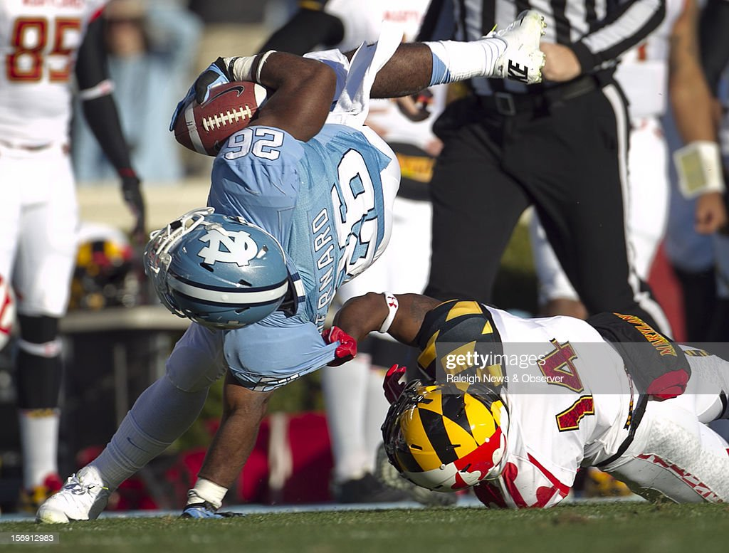 Maryland's Jeremiah Johnson (14) stops North Carolina's Giovani Bernard (26) after a 42-yard gain in the first quarter on Saturday, November 24, 2012, at Kenen Stadium in Chapel Hill, North Carolina. The host Tar Heels won, 45-38.
