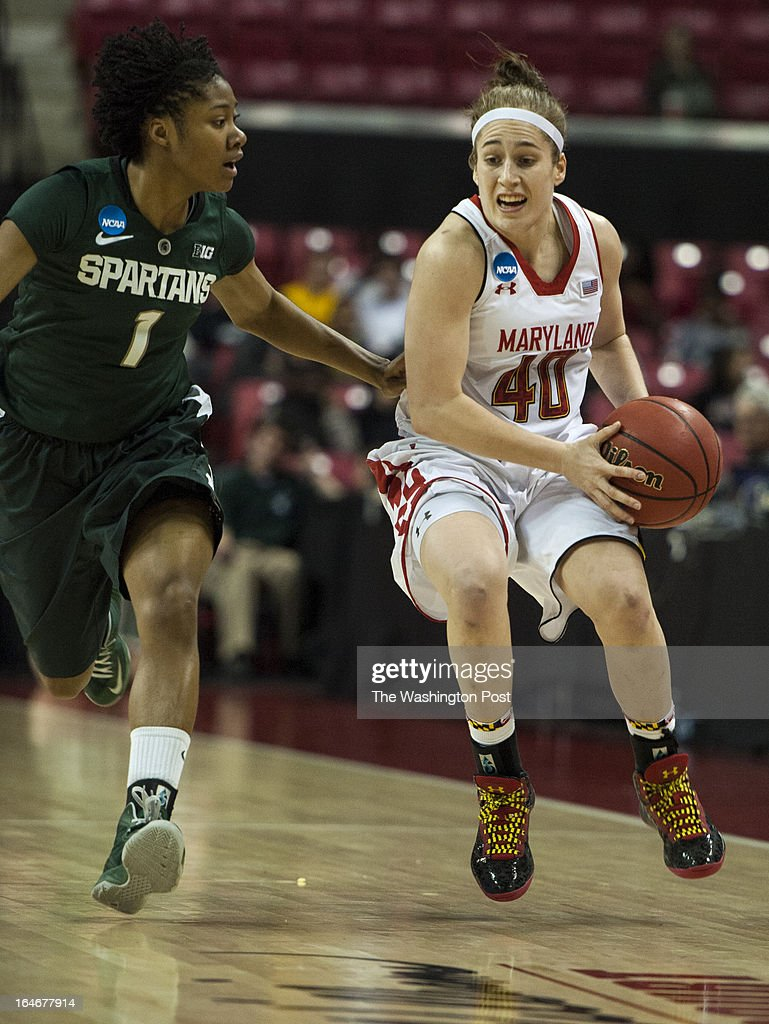 Maryland's Katie Rutan heads to the hoops ahead of Michigan's Jasmine Thomas Monday March 25, 2013 in College Park, MD at Comcast Center.