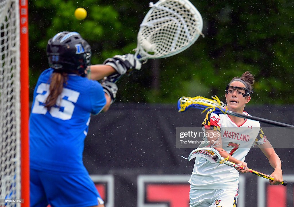 Maryland's Katie Schwarzmann, right, fires a shot at Duke's goalie Kelsey Duryea in the first half as the University of Maryland defeats Duke 14 - 9 in the NCAA women's lacrosse quarter-finals in College Park MD, May 18, 2013.