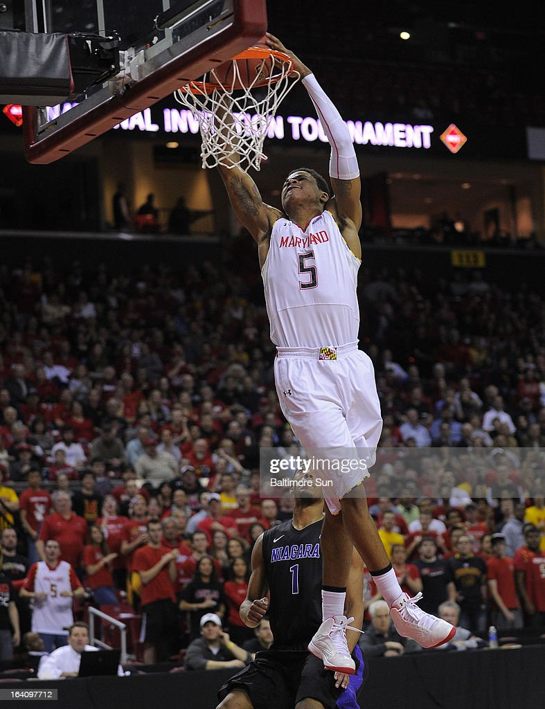 Maryland's Nick Faust dunks against Niagara's Malcolm Lemmons during first-half action in the NIT Tournament at the Comcast Center in College Park, Maryland, Tuesday, March 19, 2013.