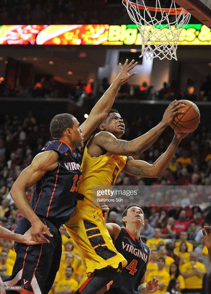 Maryland's Nick Faust makes a basket against Virginia's Justin Anderson during the first half of a men's college basketball game in College Park, Maryland, Sunday, February 10, 2013. Virginia won, 80-69.