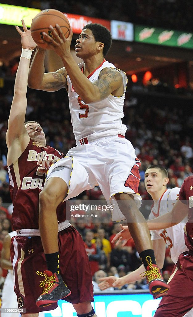 Maryland's Nick Faust (5) tries for two while being defended by Boston College's Joe Rahon in the second half at Comcast Center in College Park, Maryland, on Tuesday, January 22, 2013. Maryland won, 64-59.