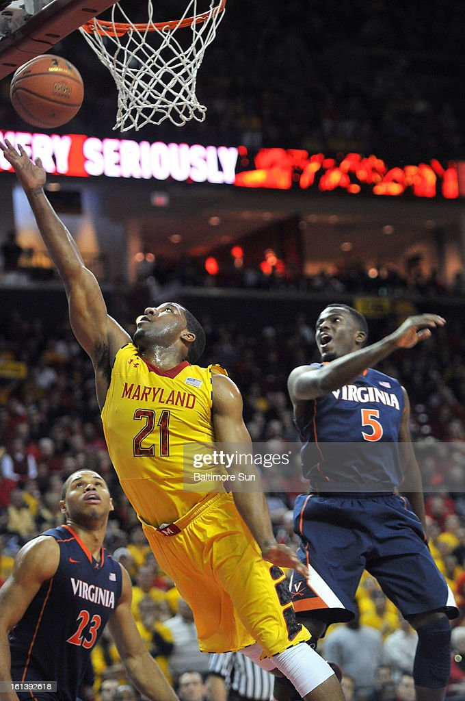 Maryland's Pe'Shon Howard puts up a shot against Virginia's Teven Jones during a men's college basketball game in College Park, Maryland, Sunday, February 10, 2013. Virginia won, 80-69.