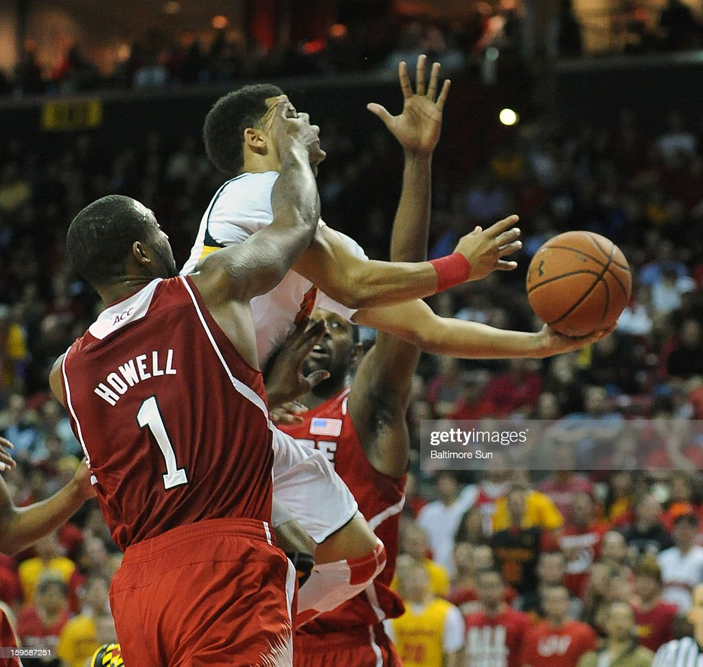 Maryland's Seth Allen gets a hand to the face from North Carolina State's Richard Howell on a first-half drive at the Comcast Center on Wednesday, January 16, 2013, in College Park, Maryland.