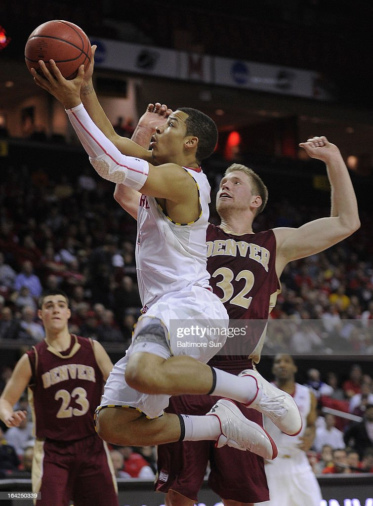 Maryland's Seth Allen gets past Denver's Chase Hallam for 2 points during the 2nd half of the NIT basketball tournament at the Comcast Center in College Park, Maryland. Maryland won, 62-52.