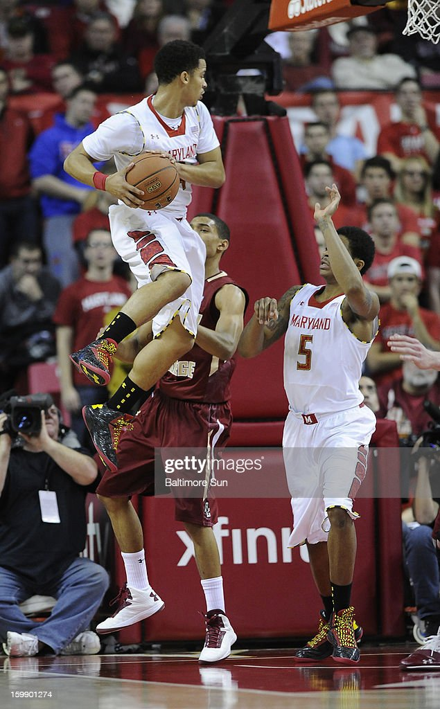 Maryland's Seth Allen jumps above Boston College's Olivier Hanlan to grab a first-half rebound at Comcast Center in College Park, Maryland, on Tuesday, January 22, 2013.
