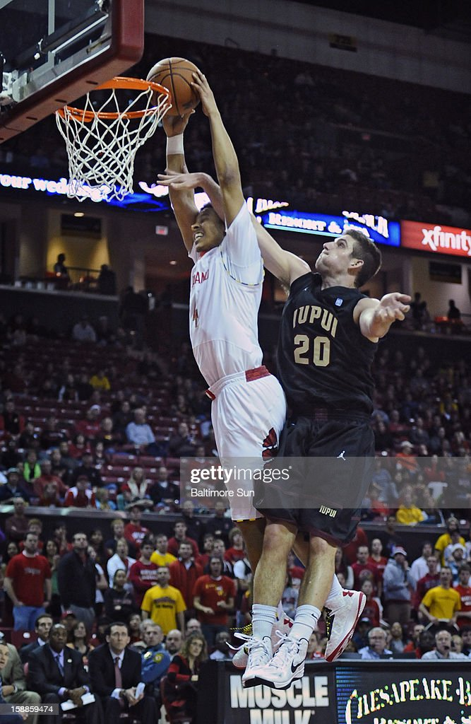 Maryland's Seth Allen, left, is fouled by IUPUI's Sean Esposito, right, on a slam-dunk in the second half of a men's college basketball game at the Comcast Center on Tuesday, January 1, 2013, in College Park, Maryland. The University of Maryland Terrapins defeated the IUPUI Jaguars, 81-63.