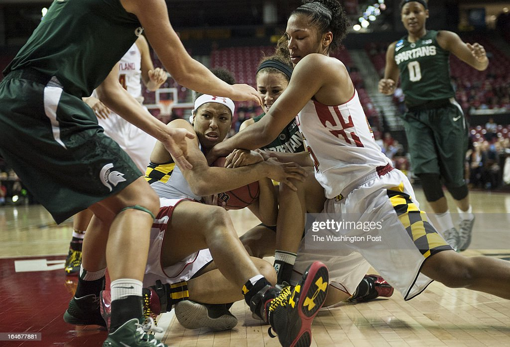 Maryland's Tianna Hawkins and Alyssa Thomas fight for possession against Michigan State in the first half of the NCAA second round Monday March 25, 2013 in College Park, MD at Comcast Center.
