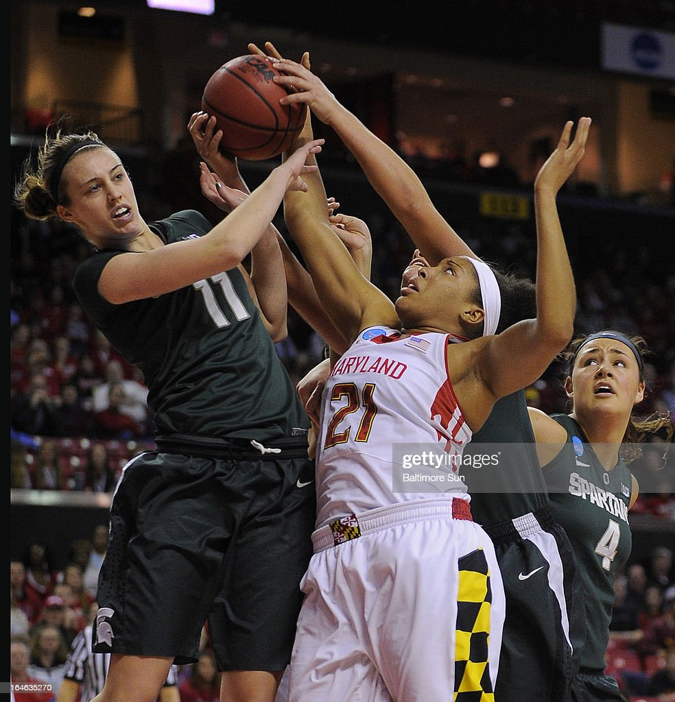 Maryland's Tianna Hawkins (21) fights for a first-half rebound with Michigan State's Annalise Pickrel (11) during the women's NCAA Tournament in College Park, Maryland, Monday, March 25, 2013.