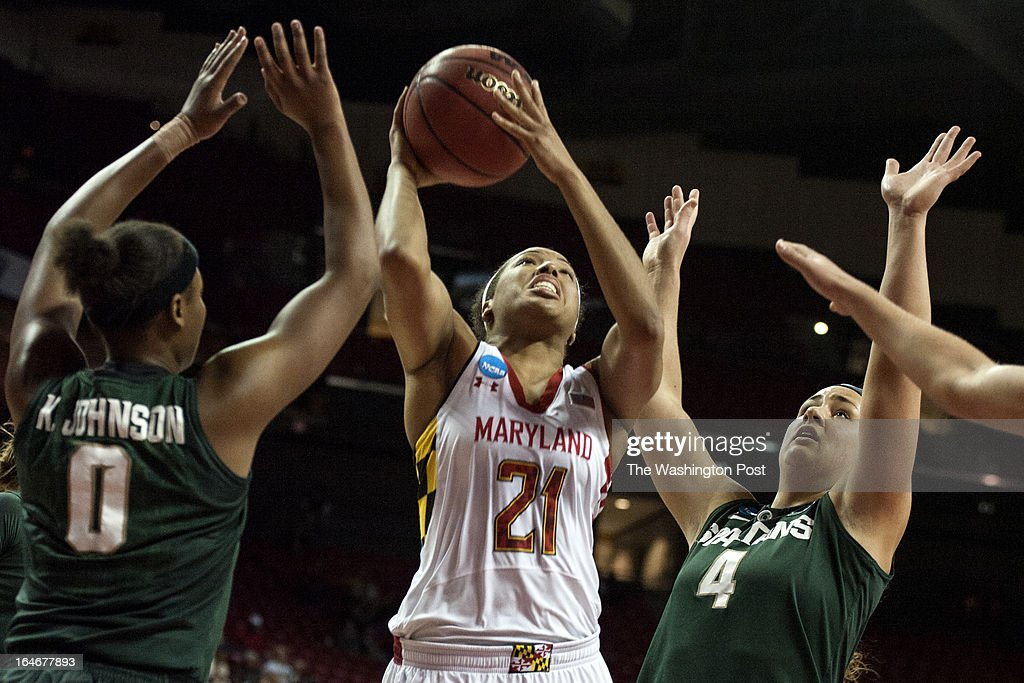 Maryland's Tianna Hawkins shoots between the Michigan State defense in the first half of the NCAA second round Monday March 25, 2013 in College Park, MD at Comcast Center.
