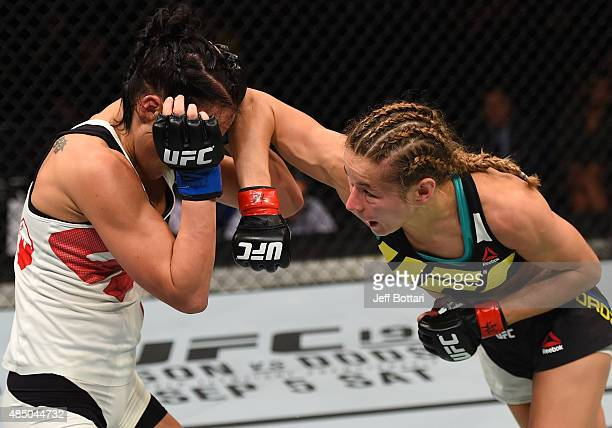 Maryna Moroz of Ukraine elbows Valerie Letourneau in their women's strawweight bout during the UFC event at the SaskTel Centre on August 23 2015 in...