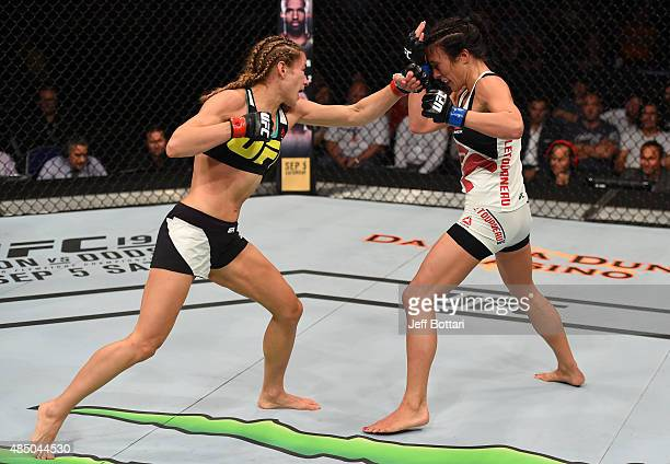 Maryna Moroz of Ukraine punches Valerie Letourneau in their women's strawweight bout during the UFC event at the SaskTel Centre on August 23 2015 in...