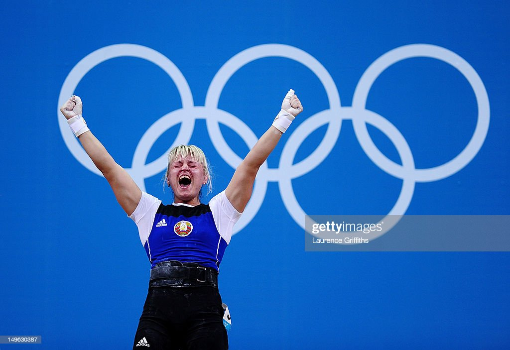 <a gi-track='captionPersonalityLinkClicked' href=/galleries/search?phrase=Maryna+Shkermankova&family=editorial&specificpeople=9609991 ng-click='$event.stopPropagation()'>Maryna Shkermankova</a> of Belarus celebrates while competing in the Women's 69kg Weightlifting on Day 5 of the London 2012 Olympic Games at ExCeL on August 1, 2012 in London, England.